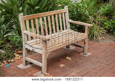 Old wooden relax bench in a city park