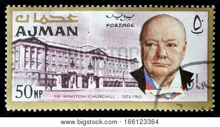 AJMAN - CIRCA 1966 : Cancelled postage stamp printed by Ajman, that shows Churchill and Buckingham palace.