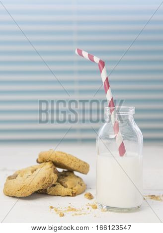 Fresh Homemade Cookies and Milk with red striped straw