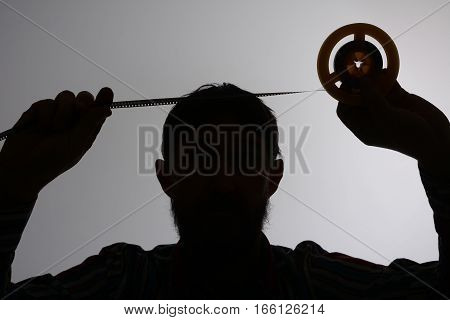 Silhouette Of Man Looking On 8Mm Film Strip