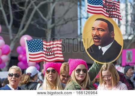 Activists With American Flags And Image Of Martin Luter King