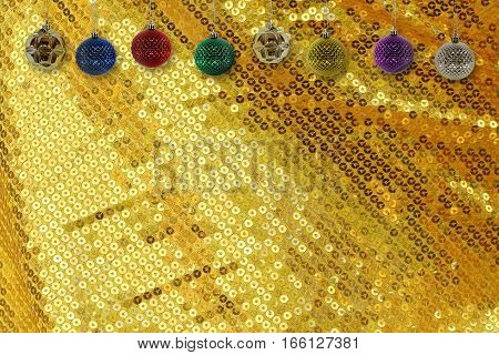 Christmas background with christmas ball on gold sparkle glittering background