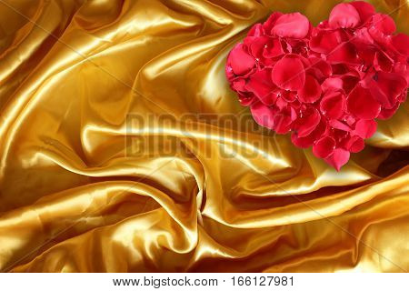 Rose petals on golden brown fabric silk for background