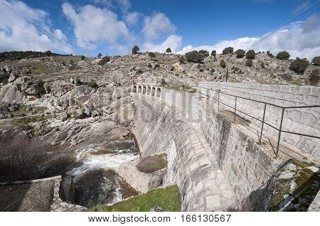 Concrete dam wall over the river Manzanares, Colmenar Viejo, Madrid, Spain