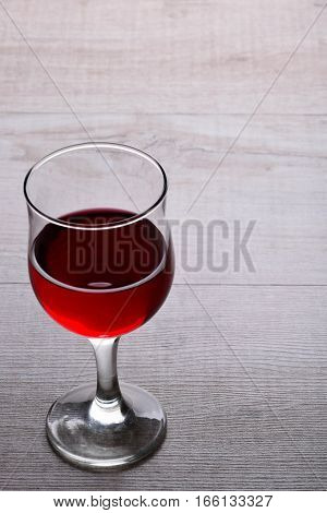 glass of red wine .glass of wine on a light wooden background