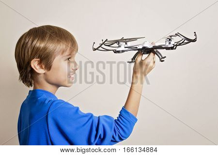 Boy playing with drone. Technology, leisure toys concept