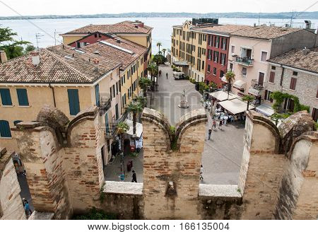 SIRMIONE, ITALY - MAY 5, 2016: View of Piazza Castello from the Scaliger Castle in Sirmione Lake Garda Italy