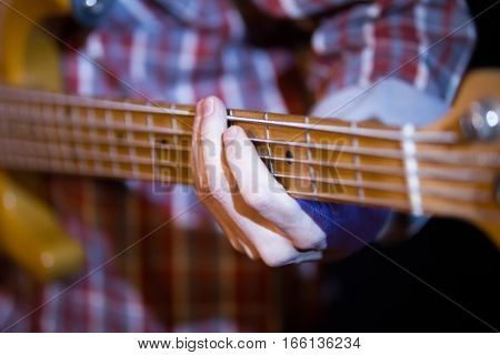 Musician in night club - guitarist holding soundboard electric guitar, close up, close up, telephoto
