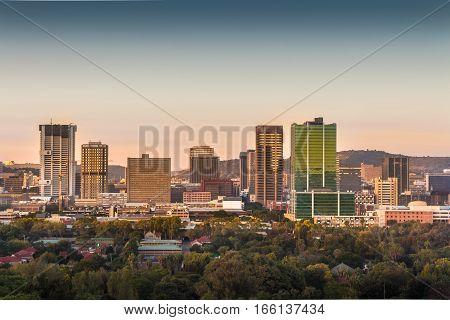 Pretoria (Tshwane), South Africa - April 17th, 2016. Sunrise view of city center skyline.