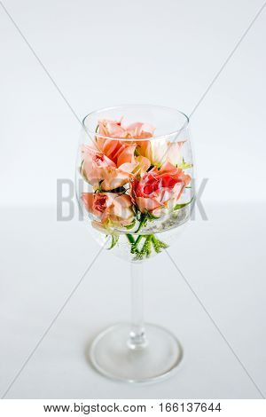 Glass with small rose flowers for wedding celebration white background