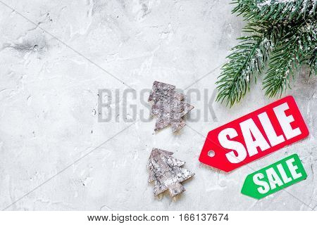 Christmas sales on gray background top view.