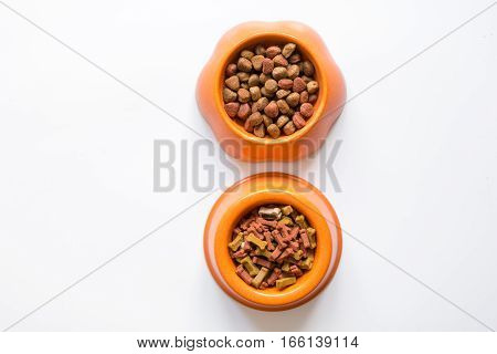 dry pet food in bowl on white background top view.