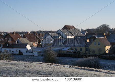 Urban skyline in backlit from Old Royal Town Ribe Jutland Denmark.