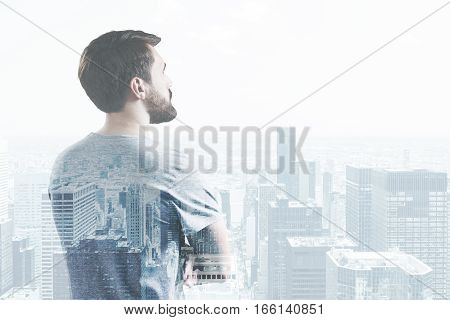 Side View Of Man Looking At Cityscape