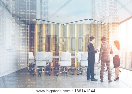 Rear view of two men and a woman in a conference room discussing work issues. Cityscape in the background. 3d rendering. Mock up. Double exposure. Toned image