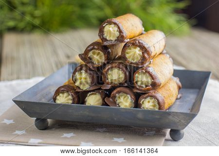 Christmas Nut Tubules With Vanilla Cream Coated In Chocolate On A Tin Tray
