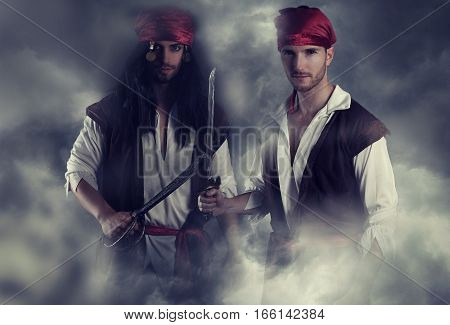 two handsome young pirate on the smoke