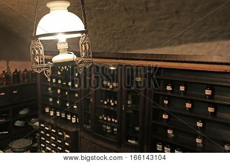 LVIV, UKRAINE - JUNE 28, 2014: Old lamp in cellar of pharmacy-museum in Lviv, Ukraine. The Pharmacy Museum in Lviv was opened in 1966 in the building of an old drugstore, at the corner of the Market Square