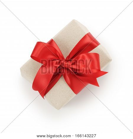 craft paper gift box with red ribbon bow on white background, shot directly above