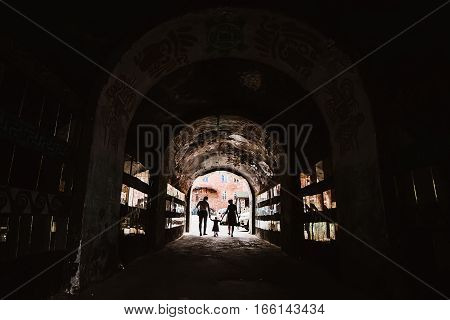 Family silhouette in a tunnel in the city
