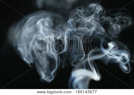 mystery dense blue smoke over dark background, abstract photo