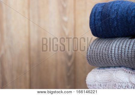 Different Pullover On Wooden Background