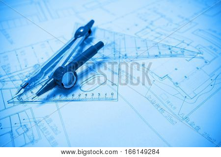 Construction planning and drawing tools (blueprint background)