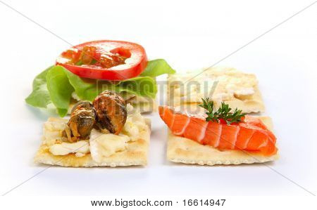 Isolated mixed hors d'oeuvres on white background