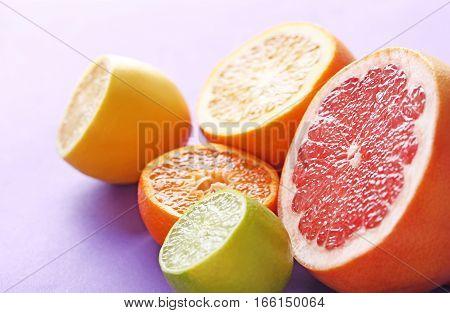 Sweet citrus fruit on a purple background