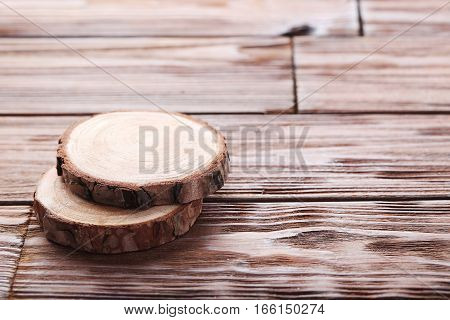 Cross Section Of Tree Trunk On Wooden Table