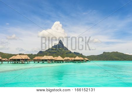 Over water bungalows into amazing green lagoon at Bora Bora island
