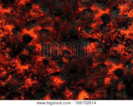 The abstract background of smoldering wood coals