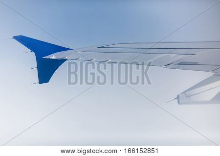 sky as seen through window of an aircraft
