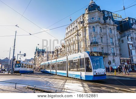 AMSTERDAM NETHERLANDS - JANUARY 17 2017: Moving tram in Amsterdam city at day time. January 17 2017 in Amsterdam - Netherland.