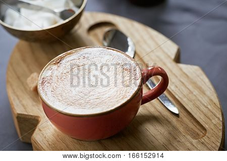 Cup of coffee on a table in cafe