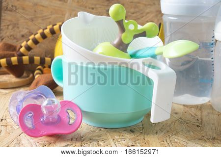 Feeding baby accessories on table- bottles teats.