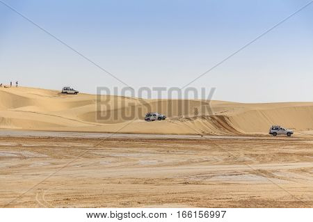 Off-road vehicle safari in typical desert landscape