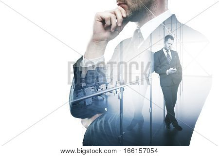 Thoughtful businessman using smartphone in modern office. Communication concept. Double exposure