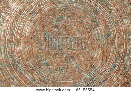 Texture of oriental circular floral ornament carved on stone texture