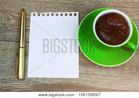 Blank Paper With Pen And Coffee Cup On Wood Table. The View From The Top