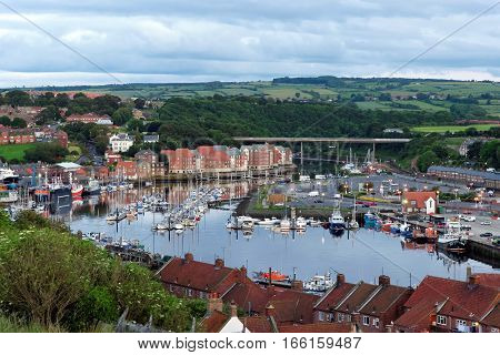 The harbor in the port of Whitby on the North Yorkshire coast in the United Kingdom. Tourism started in Whitby during the Georgian period and developed further on the arrival of the railway in 1839.