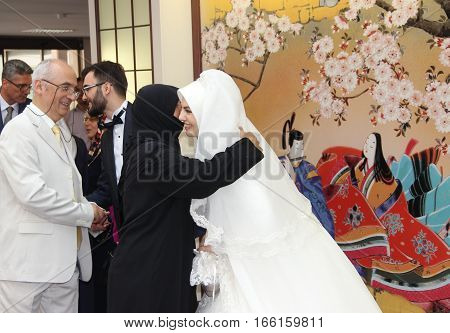 ANKARA, TURKEY - AUGUST 2, 2015 : The bride and groom with guests in the Turkish-Japan Culture Center during the wedding ceremony.