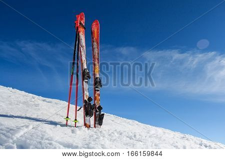 Ski equipment on scenic winter mountain background