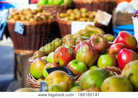 Fresh apples on display at a fruit stand of Borough Market in London