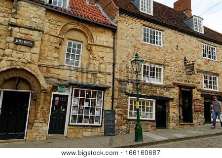 LINCOLN, UK - JULY 1, 2016: Jews house and court - a Norman building on Steep Hill in the historic quarter of Lincoln City Centre Lincolnshire.