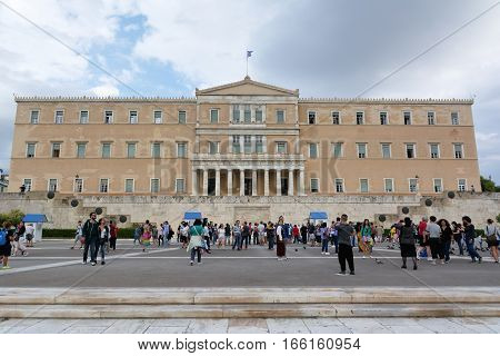 ATHENS, GREECE - SEPTEMBER 22, 2016: The Greek parliament and the monument of the unknown soldier with guards in Athens, Greece.