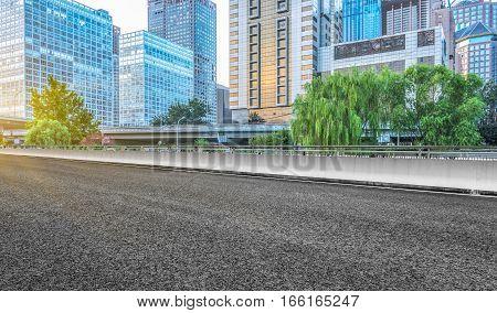 empty asphalt highway with city skyline on background,china.