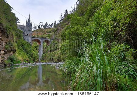 the Las Lajas sanctuary seen from the river in the valley beneath
