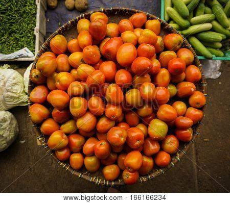 Tomato in a basket sold in traditional market photo taken in pasar minggu jakarta java