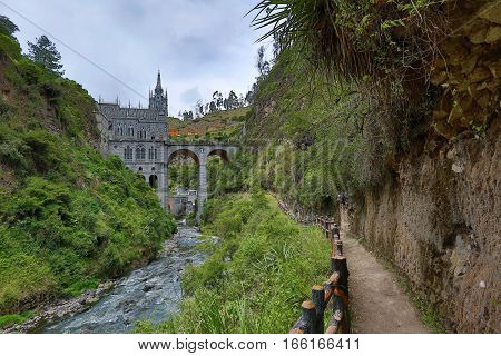 the Las Lajas sanctuary seen from the hiking path in the valley beneath